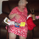 Mom quickly got into the spirit as she opened cards and emptied her stocking.